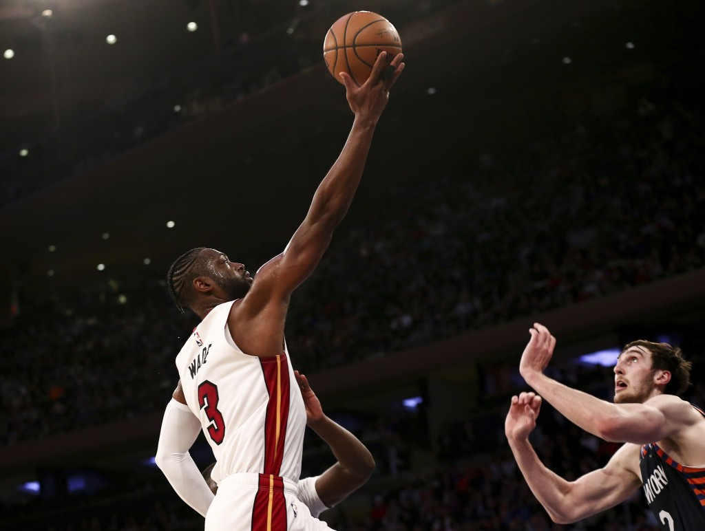Miami Heat guard Dwyane Wade (3) shoots against New York Knicks forward Luke Kornet (2) during the first half of an NBA basketball game Saturday March