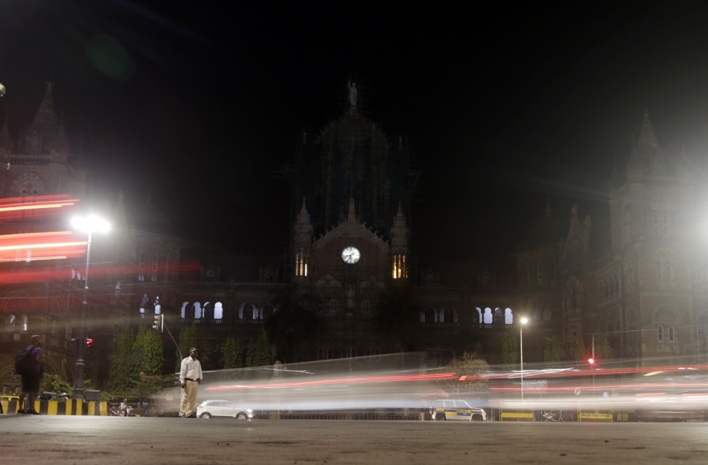 Mumbai's historic railway station Chhatrapati Shivaji Maharaj Terminus is seen after the lights were switched off for Earth Hour, in Mumbai, India, Sa