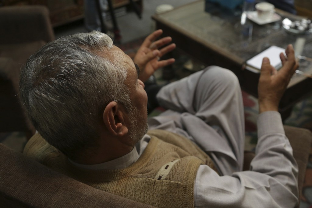 In this Feb. 17, 2019 photo, a village elder speaks during an interview with The Associated Press, in Kabul, Afghanistan. Security officials worry tha