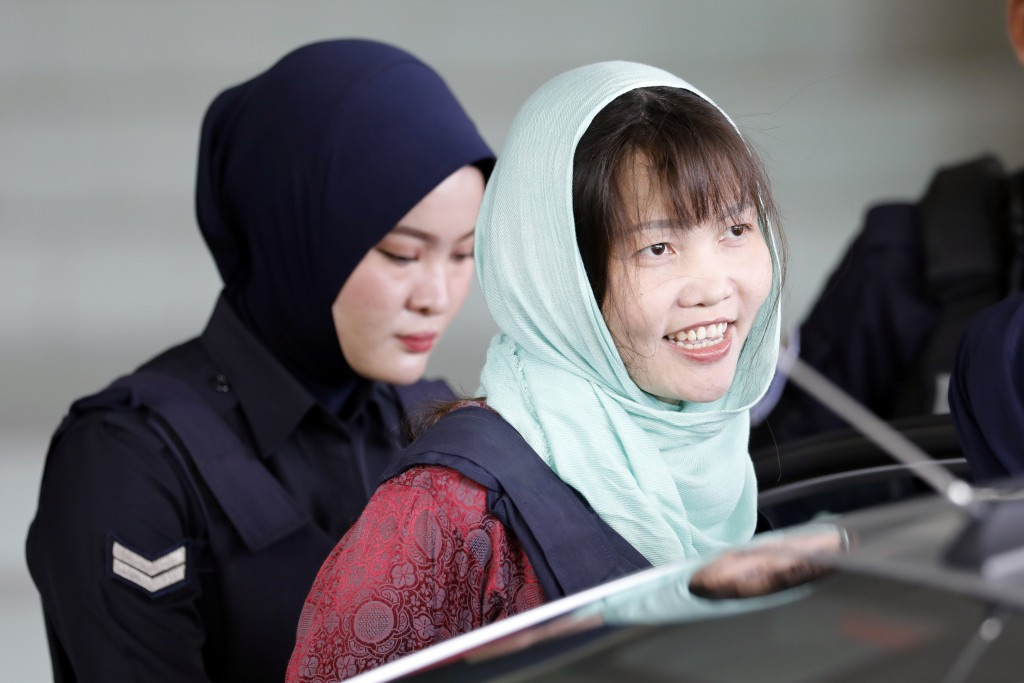 In this Monday, April 1, 2019, file photo, Vietnamese Doan Thi Huong, right, leaves Shah Alam High Court in Shah Alam, Malaysia. The Vietnamese woman