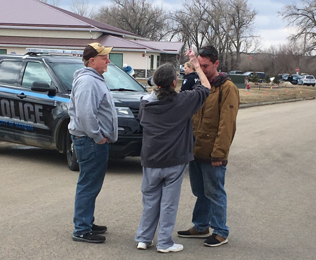 Gina Kessel, center, comforts her son Mitchell outside of RJR Maintenance and Management, a property management company, Monday, April 1, 2019, Mandan...