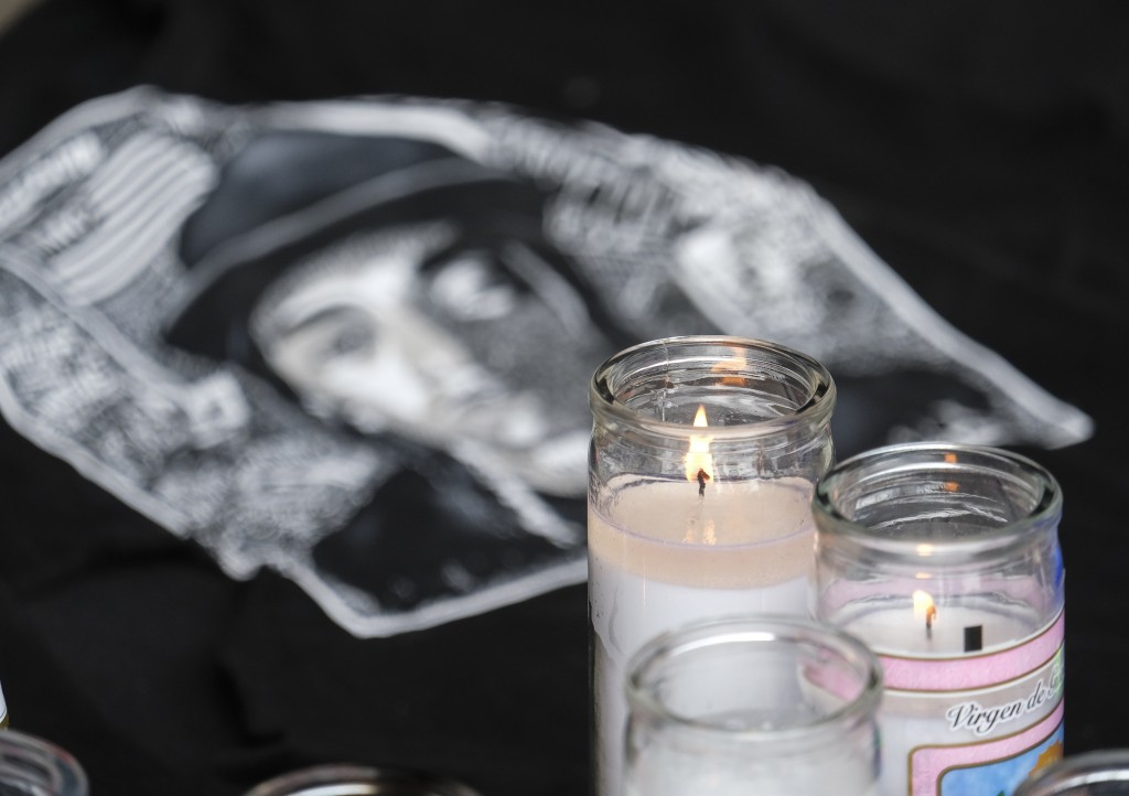 Candles appear at a makeshift memorial for rapper Nipsey Hussle in the parking lot of his Marathon Clothing store in Los Angeles, Monday, April 1, 201...