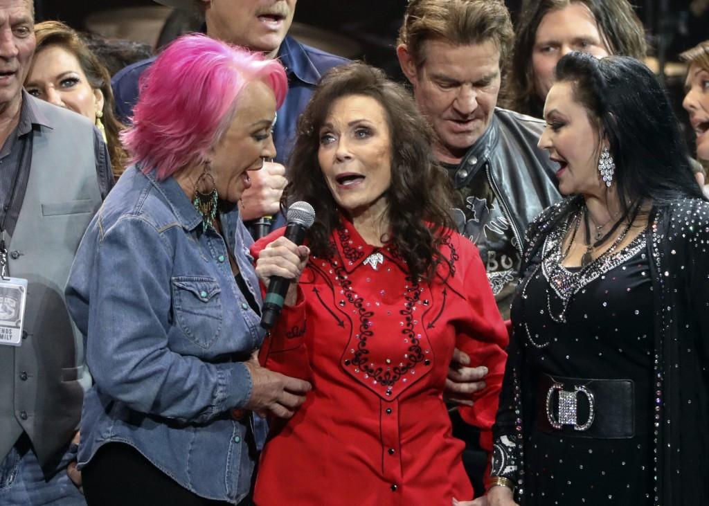 Loretta Lynn, center, Tanya Tucker, left, and Crystal Gayle perform at Loretta Lynn's 87th Birthday Tribute at Bridgestone Arena on Monday, April 1, 2