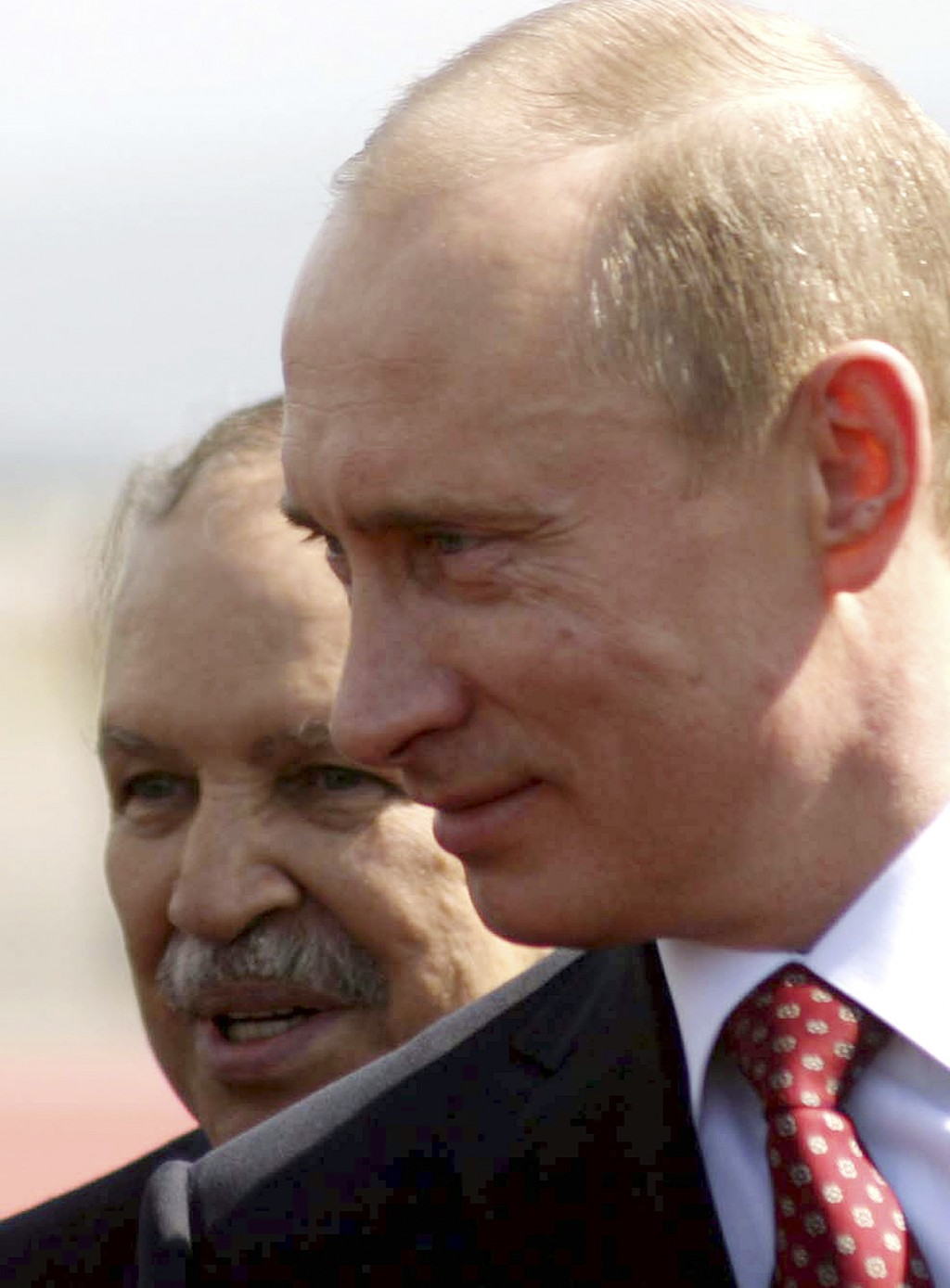 FILE -  In this March 10, 2006 file photo, Algerian President Abdelaziz Bouteflika, behind, and his Russian counterpart Vladimir Putin are pictured at...