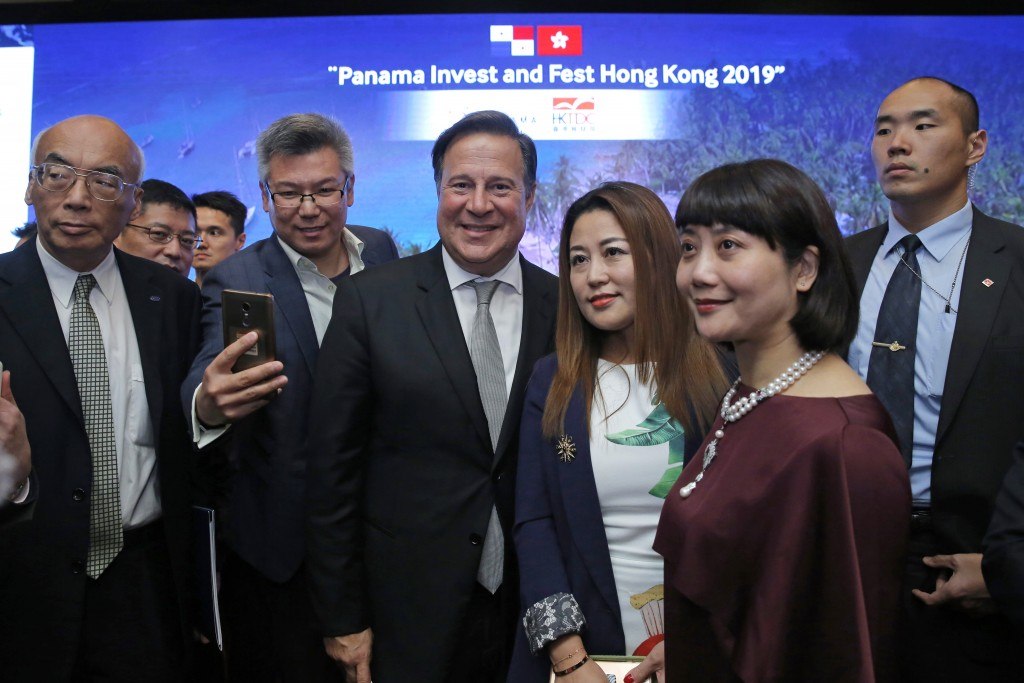 FILE - In this Tuesday, April 2, 2019, file photo, Panama's President Juan Carlos Varela Rodríguez, center, poses with his guests after a conference o...