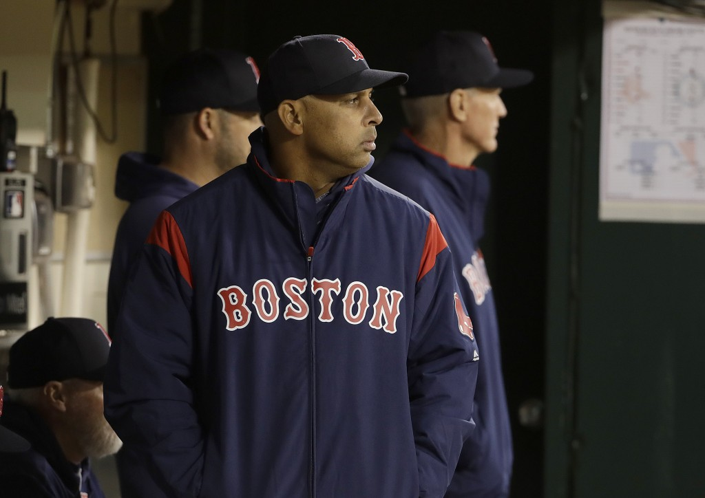 Boston Red Sox manager Alex Cora watches from the dugout during the fifth inning of a baseball game against the Oakland Athletics in Oakland, Calif.,