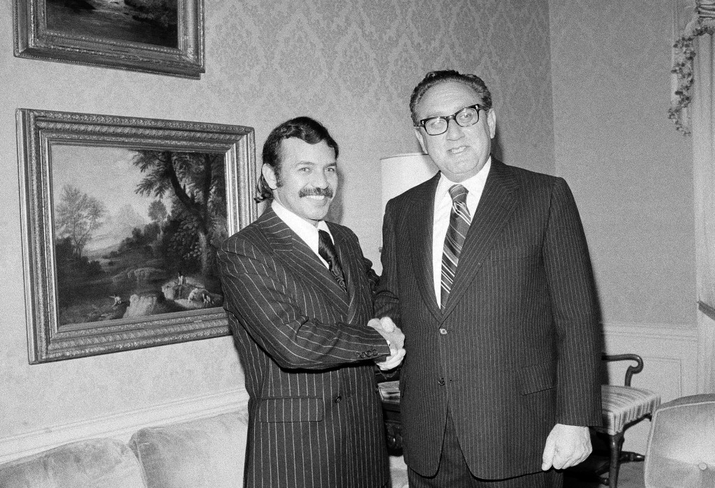 FILE - In this Oct. 1, 1975 file photo Abdelaziz Bouteflika, left, meets with U.S. Secretary of State Henry Kissinger at the U.S. State Department sui...