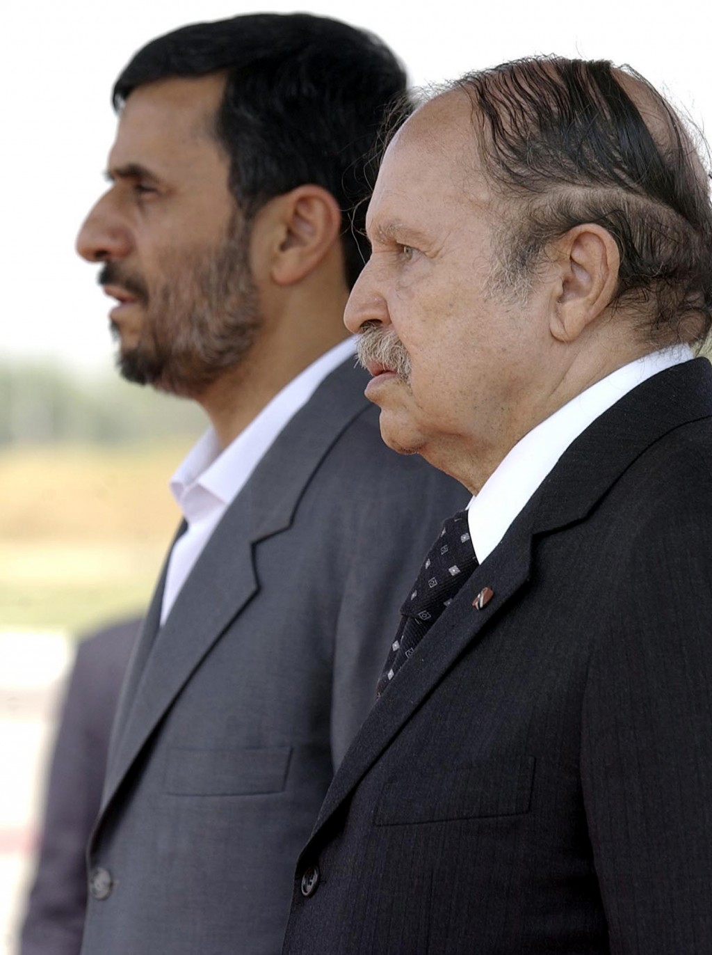 FILE - In this Aug.6, 2007 file photo, Algerian President Abdelaziz Bouteflika, right, and Iranian President Mahmoud Ahmadinejad listen to national an...