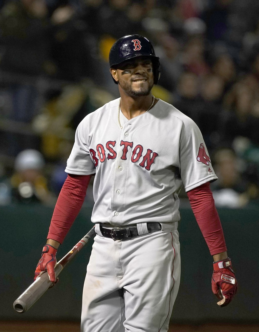 Boston Red Sox's Xander Bogaerts walks back to the dugout after striking out against the Oakland Athletics during the sixth inning of a baseball game