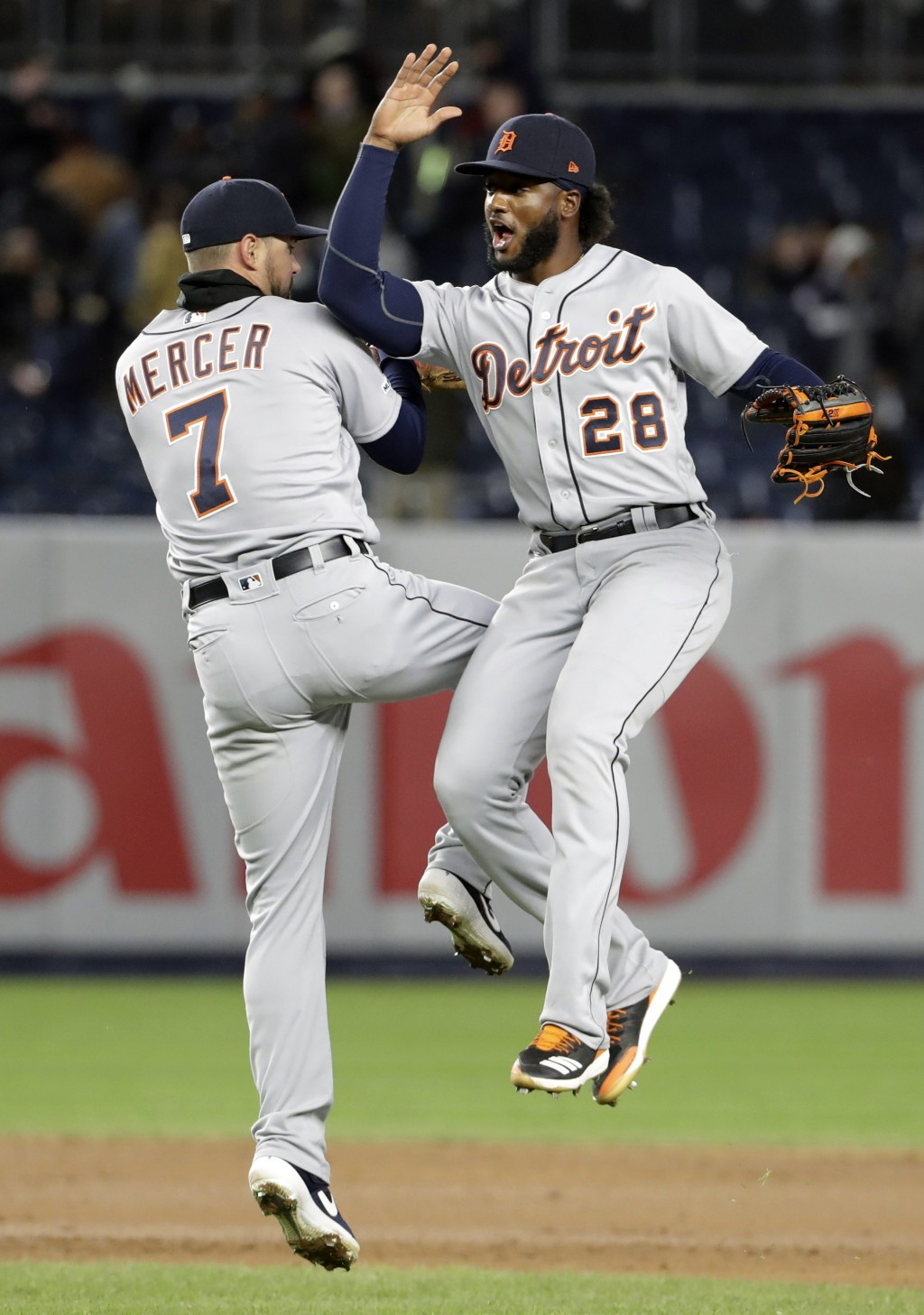 Detroit Tigers shortstop Jordy Mercer (7) and outfielder Niko Goodrum (28) celebrate after defeating the New York Yankees in a baseball game against t