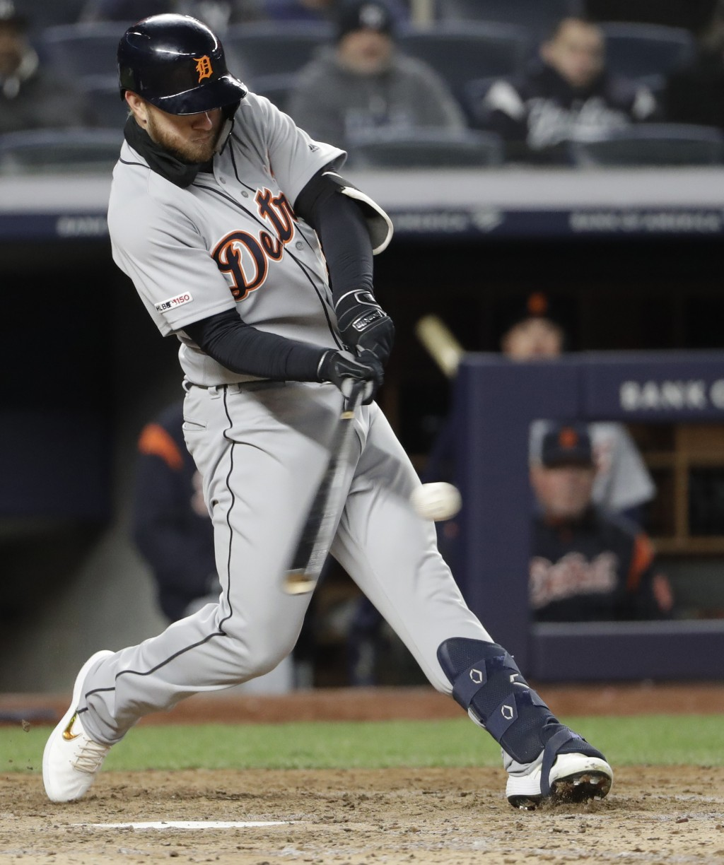 Detroit Tigers' Dustin Peterson hits a ninth-inning RBI double to drive in the winning run in the Tigers 3-1 victory over the New York Yankees in a ba
