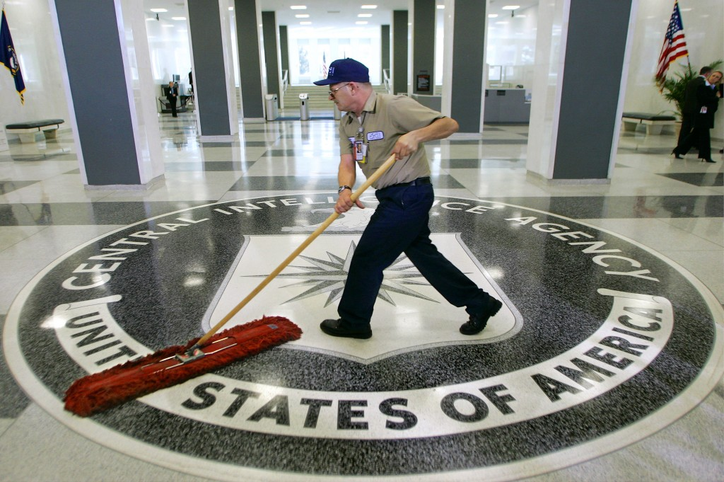 FILE - In this March 3, 2005, file photo, a workman dusts the floor at the Central Intelligence Agency headquarters in Langley, Va. The American Civil