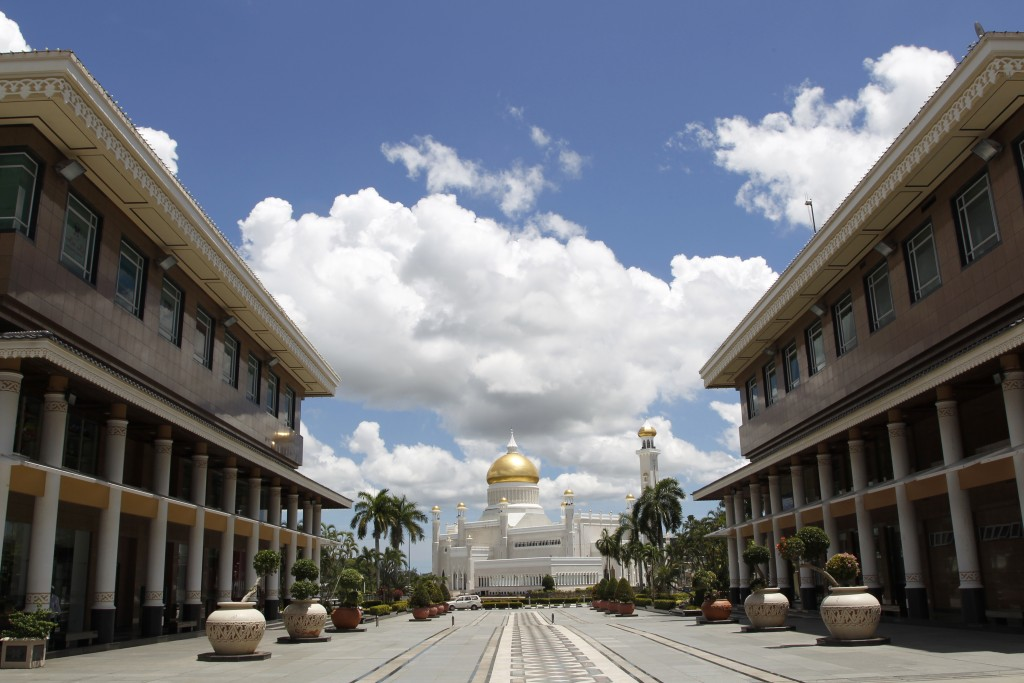 In this April 23, 2013, photo, Sultan Omar Ali Saifuddien Mosque, one of the landmarks of Bandar Seri Begawan in Brunei. Brunei announced to implement