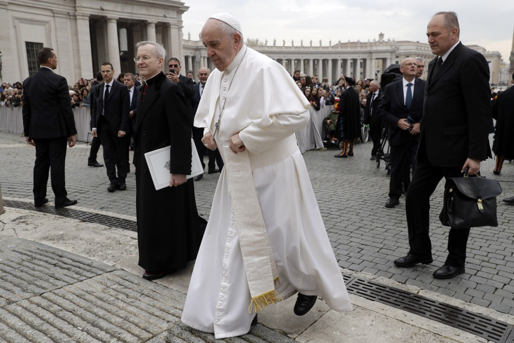 Pope Francis arrives for his weekly general audience, in St. Peter's Square, at the Vatican, Wednesday, April 3, 2019. (AP Photo/Gregorio Borgia)
