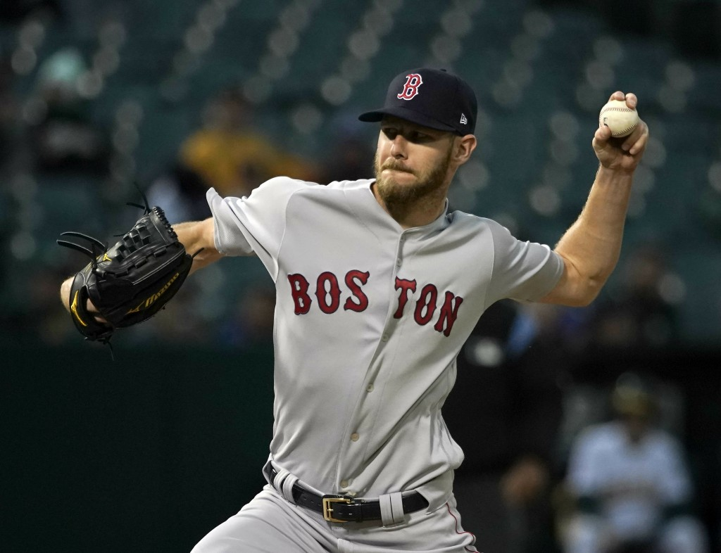 Boston Red Sox starting pitcher Chris Sale (41) throws against the Oakland Athletics during the first inning of a baseball game in Oakland, Calif., Tu