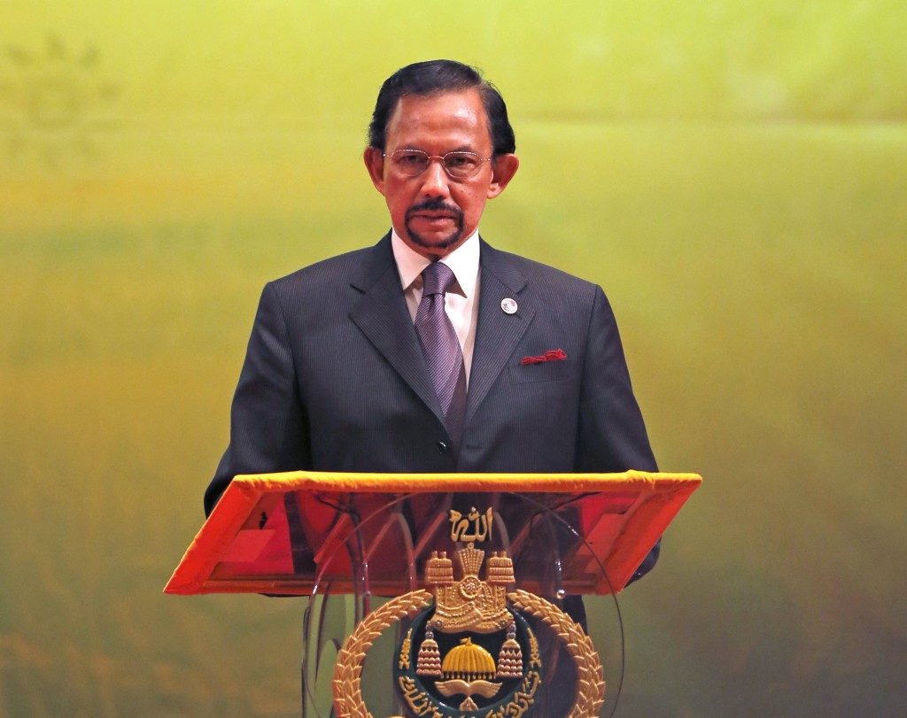 In this Oct, 10, 2013, photo, Brunei's Sultan Hassanal Bolkiah speaks during the closing ceremony and handover of the ASEAN Chairmanship to Myanmar in...
