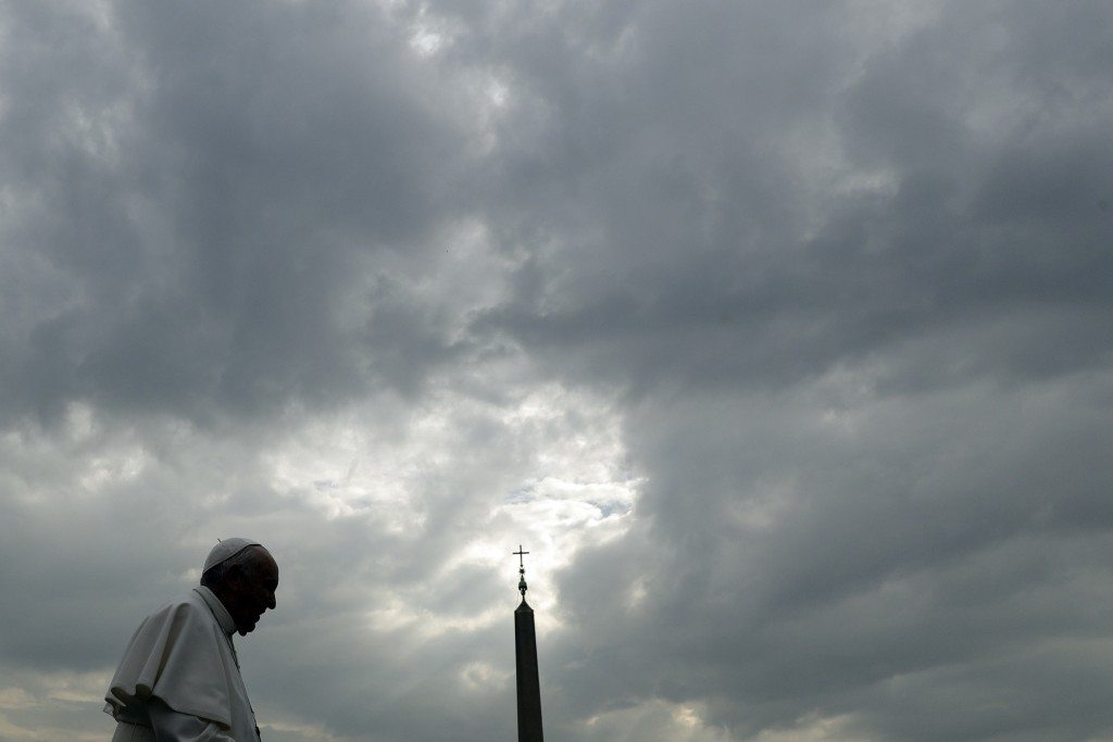 Pope Francis is silhouetted against a cloudy sky as he arrives for his weekly general audience, in St. Peter's Square, at the Vatican, Wednesday, Apri