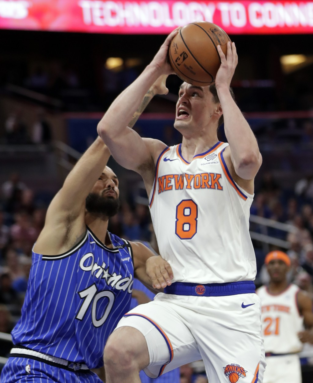 New York Knicks' Mario Hezonja (8) goes up for a shot against Orlando Magic's Evan Fournier (10) during the first half of an NBA basketball game Wedne...
