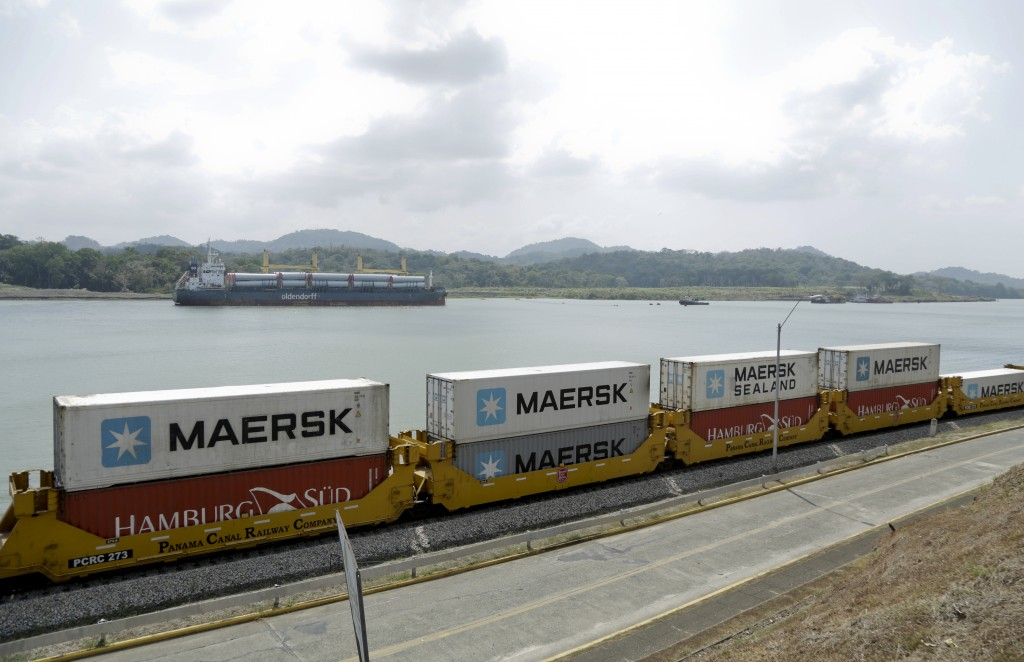 In this Feb. 25, 2019, photo, a Panama Canal railway train transport containers from the Atlantic to the Pacific Ocean alongside the Panama Canal in G...