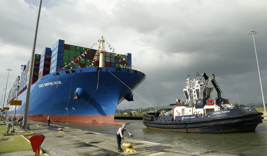 In this Dec. 3, 2018, photo, a Panama Canal worker docks the Chinese container ship Cosco at the Panama Canals' Cocoli Locks, in Panama City. China's ...