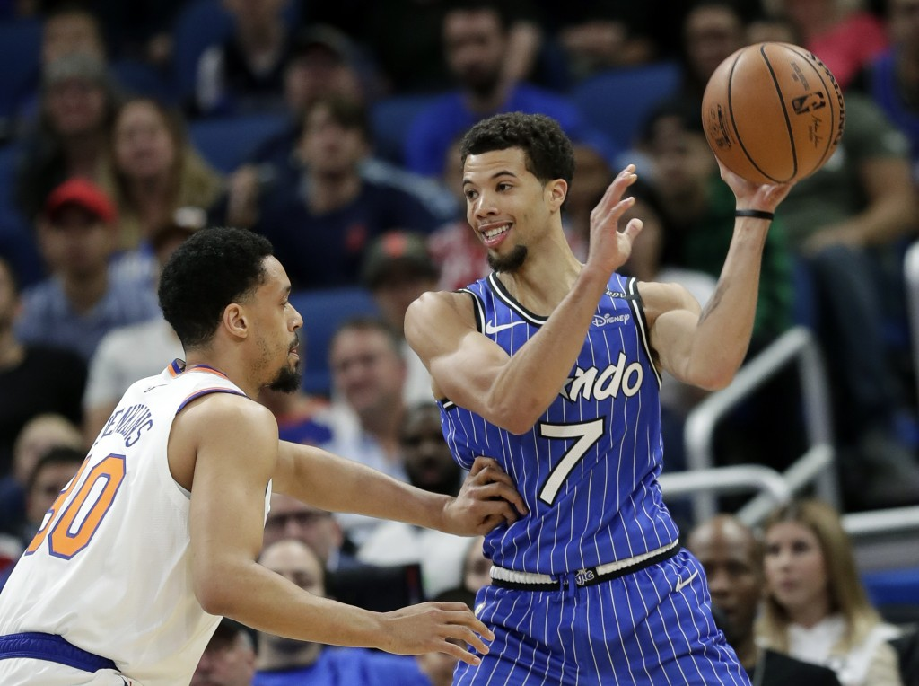 Orlando Magic's Michael Carter-Williams (7) passes the ball as New York Knicks' John Jenkins defends during the first half of an NBA basketball game W...