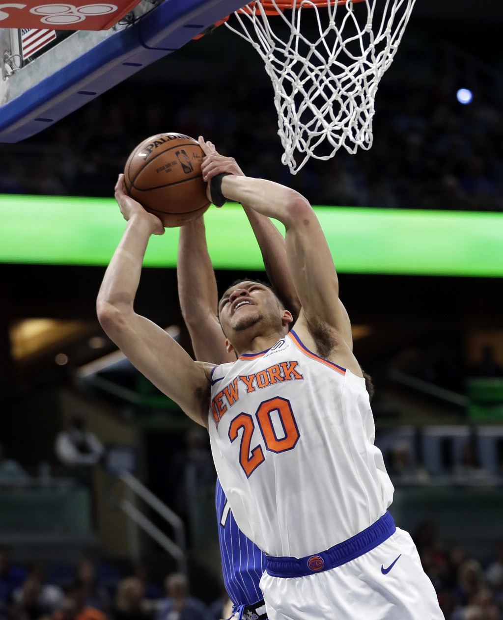 New York Knicks' Kevin Knox (20) has his shot locked by Orlando Magic's Michael Carter-Williams during the first half of an NBA basketball game Wednes...