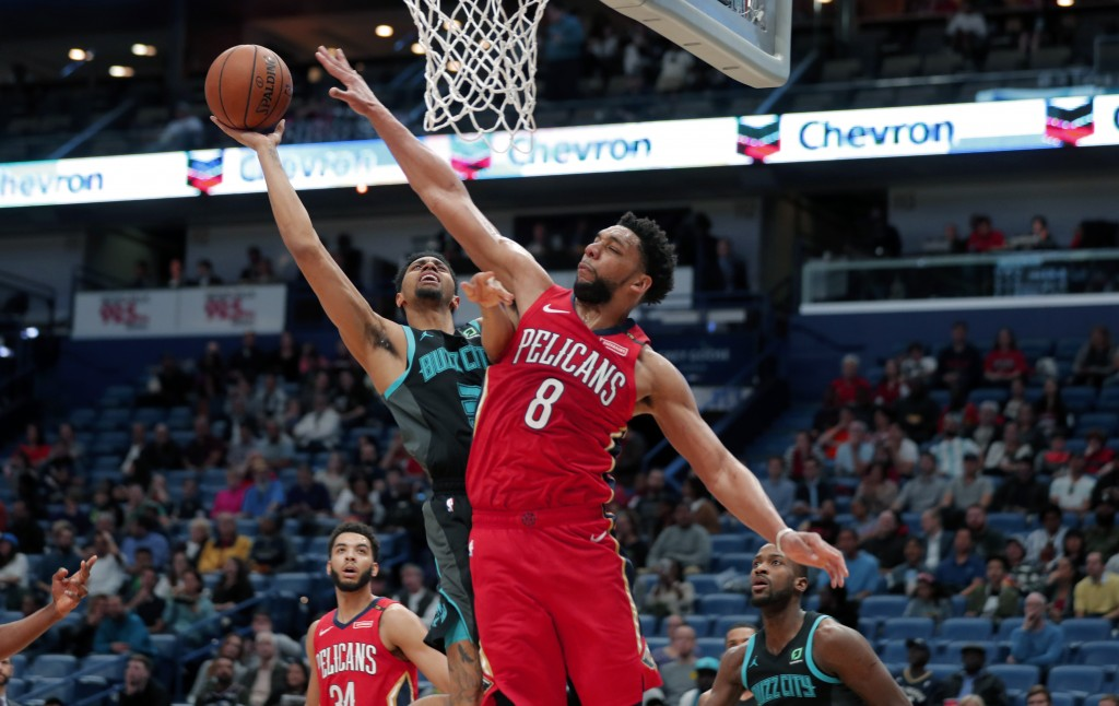9a15ec31092 New Orleans Pelicans center Jahlil Okafor (8) tries to block Charlotte  Hornets guard Jeremy