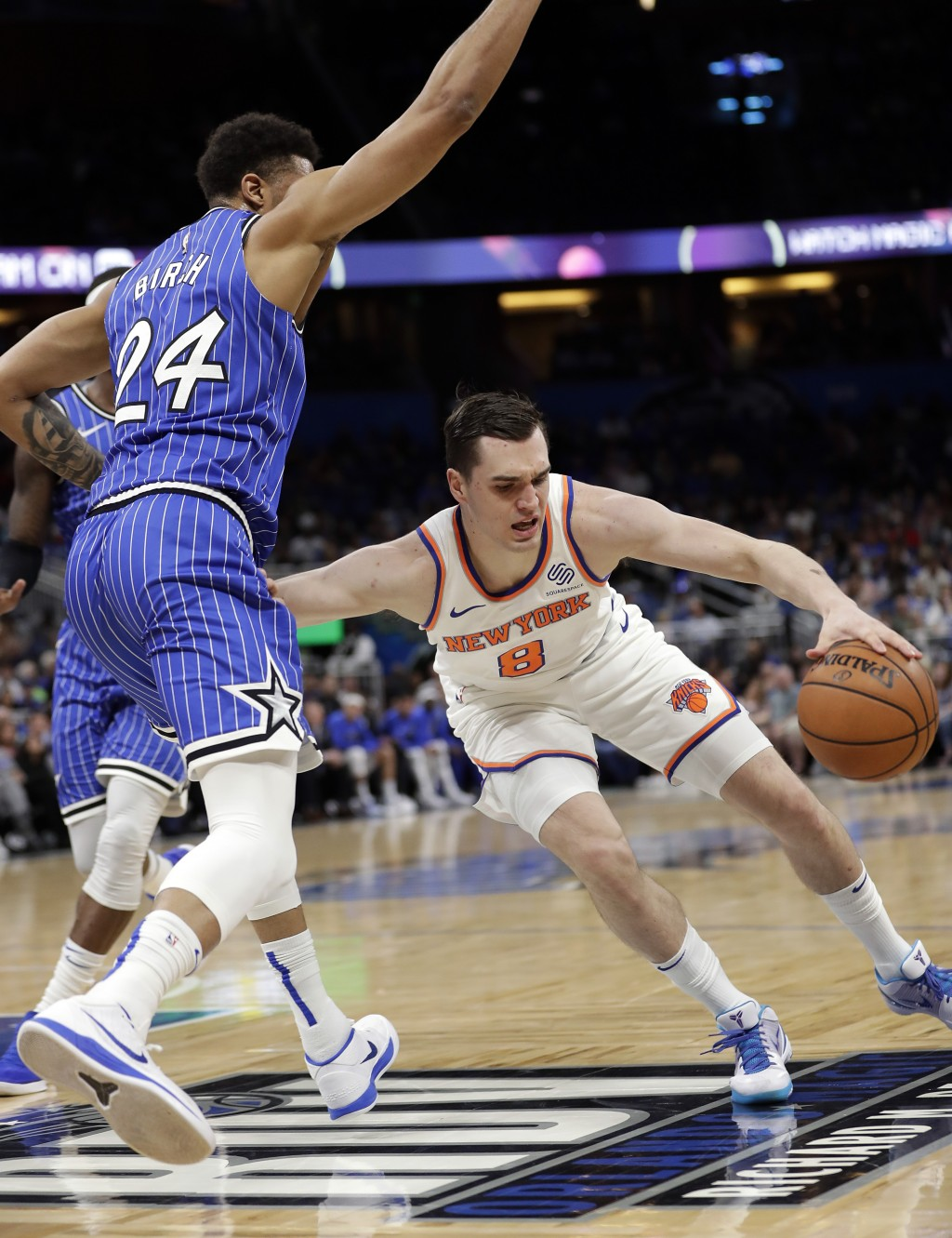 New York Knicks' Mario Hezonja, right, works to get around Orlando Magic's Khem Birch (24) during the first half of an NBA basketball game Wednesday, ...