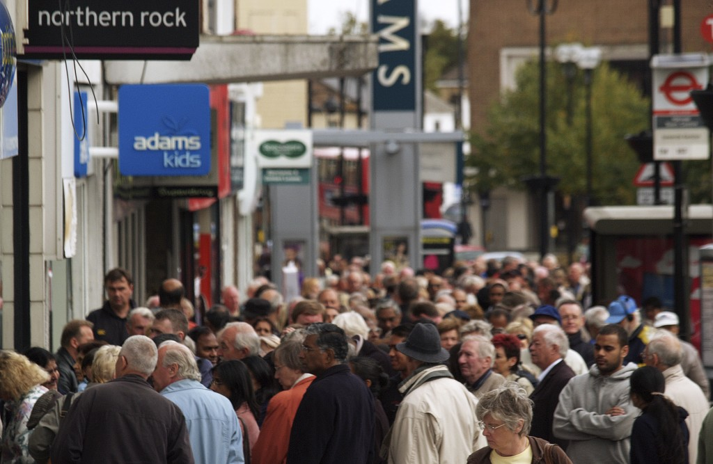 FILE - In this Sept. 17, 2007 file photo, customers stand in a queue outside a branch of the Northern Rock bank in Harrow, London. The bank experience