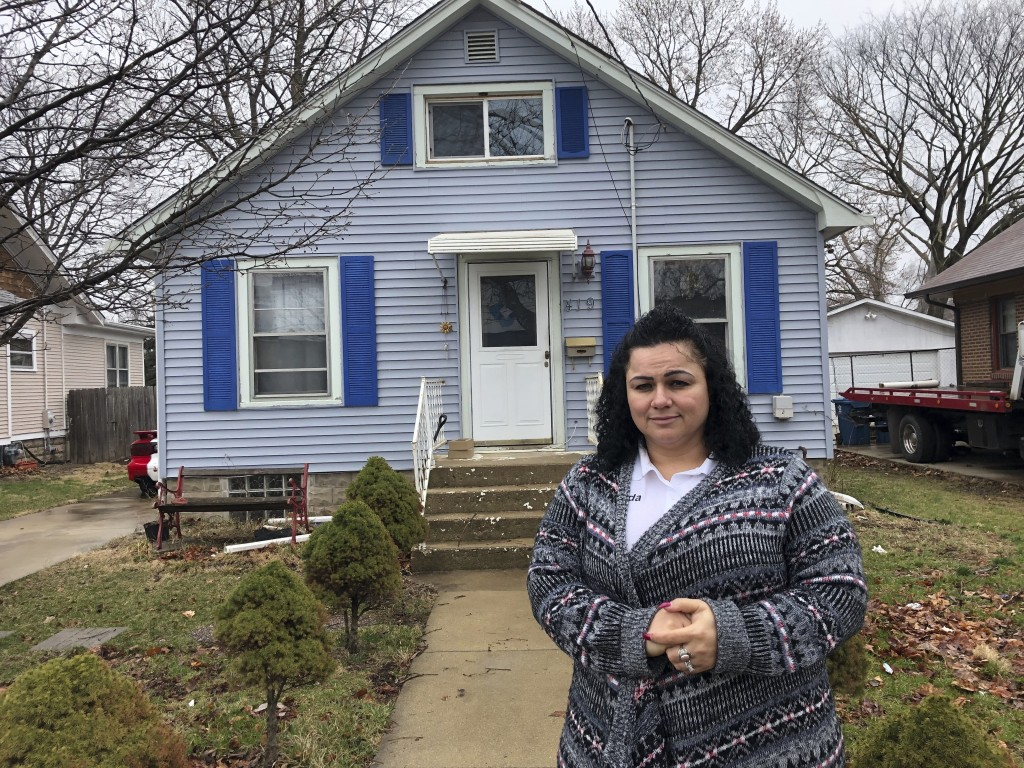 Linda Ramirez stands in front of her house in Aurora, Ill., Thursday, April 4, 2019, where she is waiting to learn if a 14-year-old who told police he...