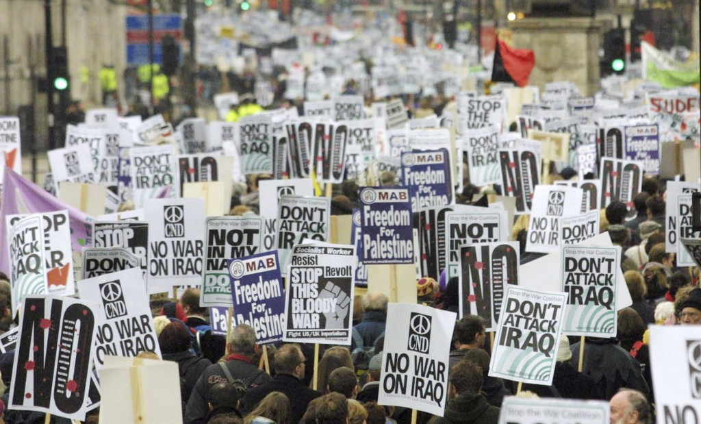 FILE - In this Feb. 15, 2003 file photo, anti-war protesters pack London's Whitehall during a march to demonstrate against a possible war against Iraq...