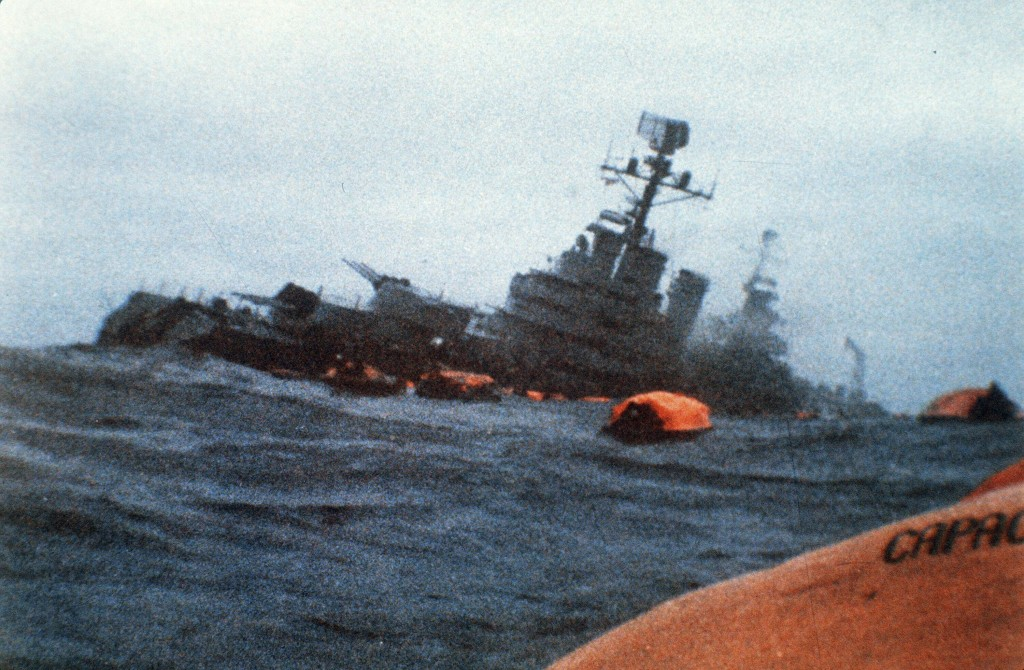 FILE - In this May 1, 1982 file photo, the Argentine cruiser General Belgrano sinks in the South Atlantic Ocean, after being torpedoed by the British