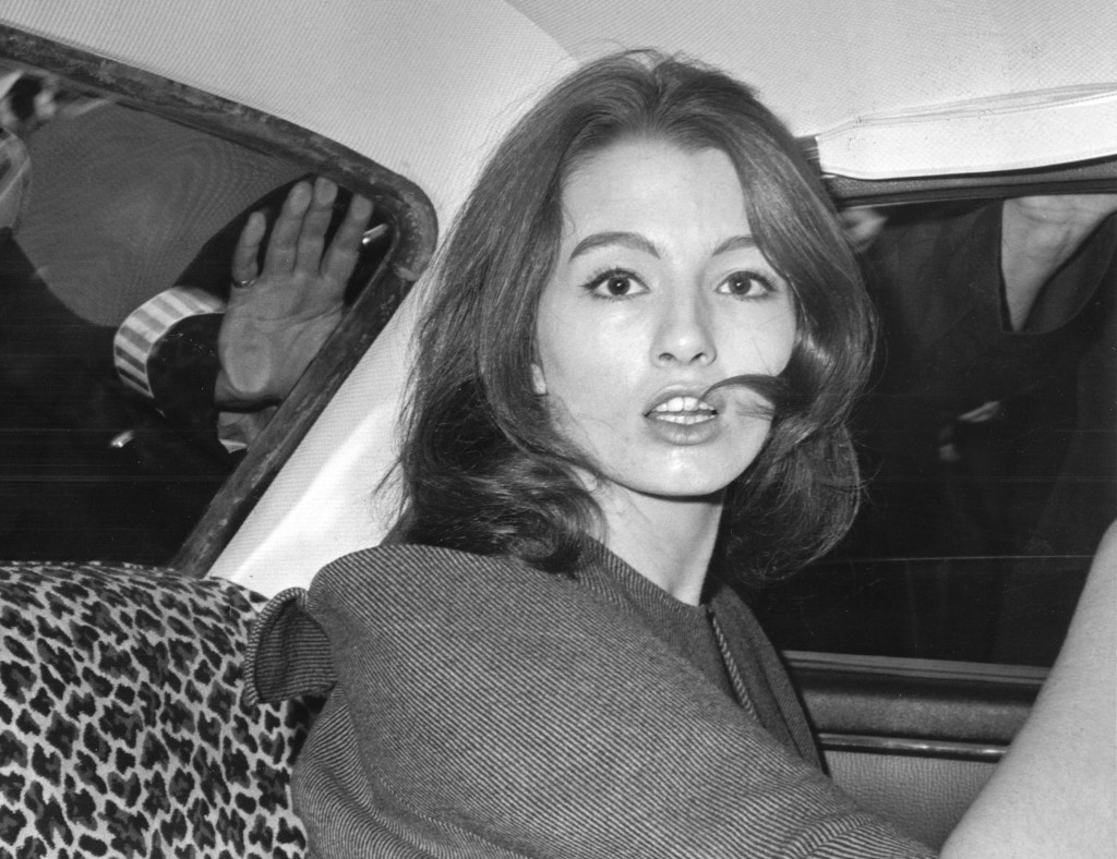 FILE - In this July 22, 1963 file photo, Christine Keeler is photographed during a vice charges case against osteopath Dr. Stephen Ward. The model had