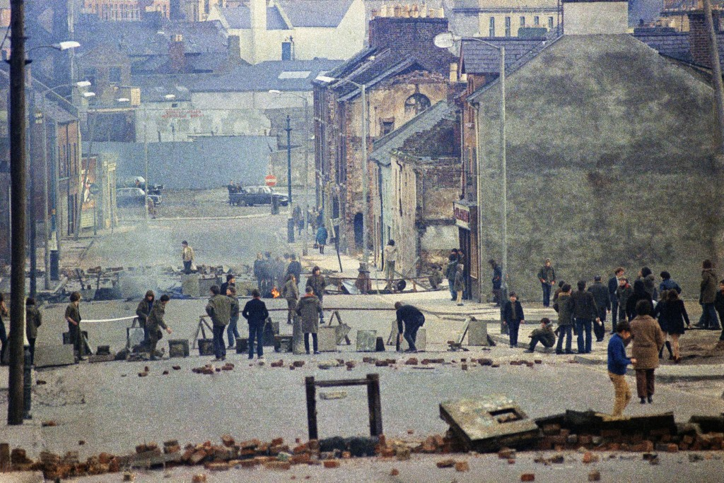 FILE - In this Feb. 1972 file photo, British troops release smoke bombs to control minor but persistent disturbances in Northern Ireland, which descen