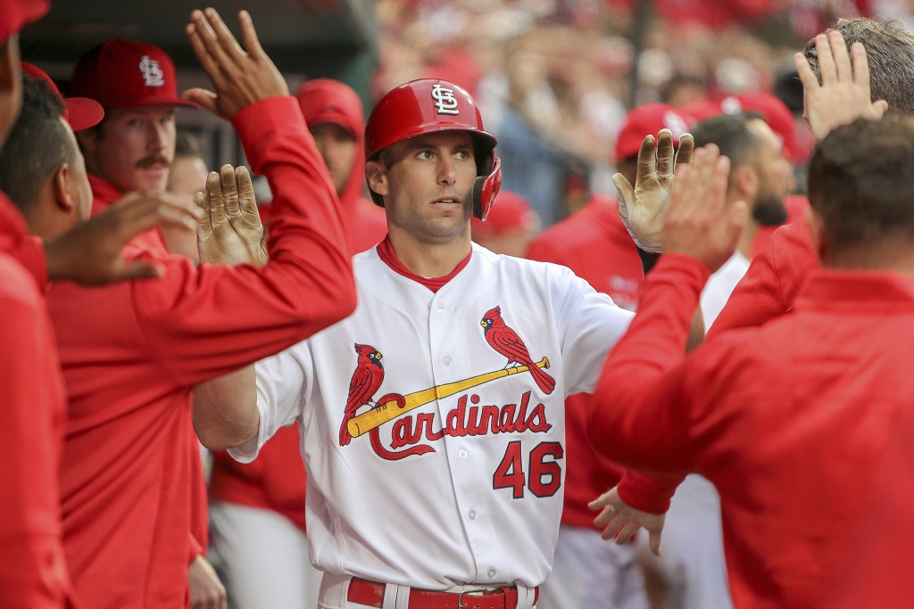 St. Louis Cardinals' Paul Goldschmidt is congratulated by teammates after hitting a solo home run during the eighth inning of a baseball game against