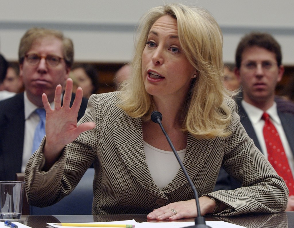 FILE- In this March 16, 2007 file photo, former CIA operative Valerie Plame gestures while testifying on Capitol Hill before the U.S. House Oversight
