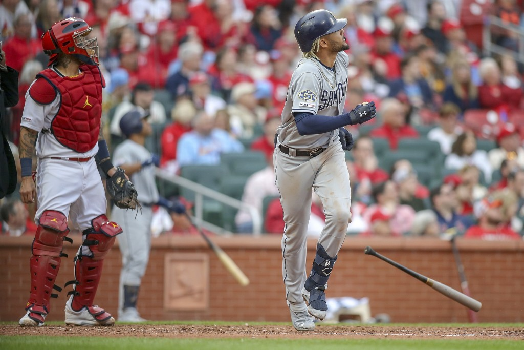 St. Louis Cardinals catcher Yadier Molina (4) and San Diego Padres' Fernando Tatis Jr. watch Tatis' two-run home run during the seventh inning of a ba