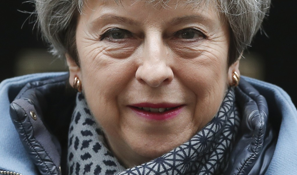 FILE - In this March 27, 2019, file photo, Britain's Prime Minister Theresa May leaves 10 Downing Street to attend her weekly Prime Minster's Question