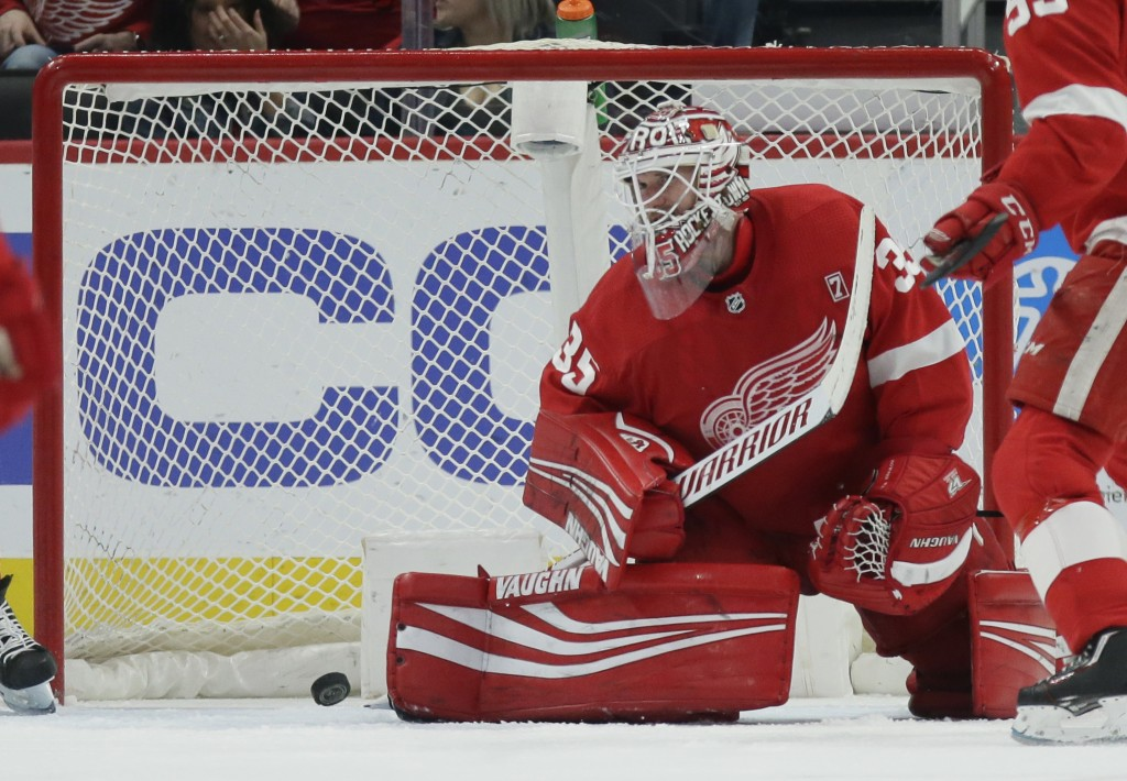 Detroit Red Wings goaltender Jimmy Howard (35) cannot stop a shot by Buffalo Sabres left wing Conor Sheary during the second period of an NHL hockey g...