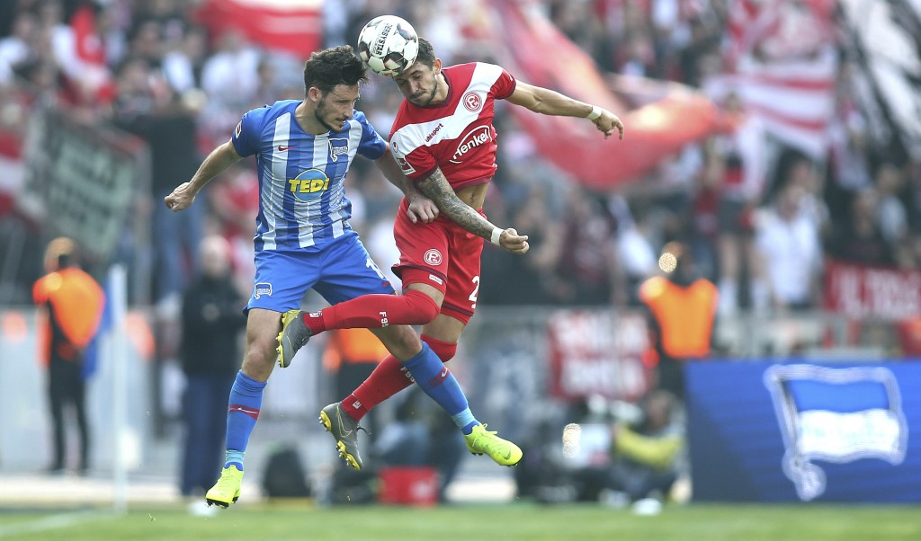 Berlin's Mathew Leckie, left, and Duesseldorf's Matthias Zimmermann challenge for the ball during the Bundesliga soccer match between Hertha BSC Berli
