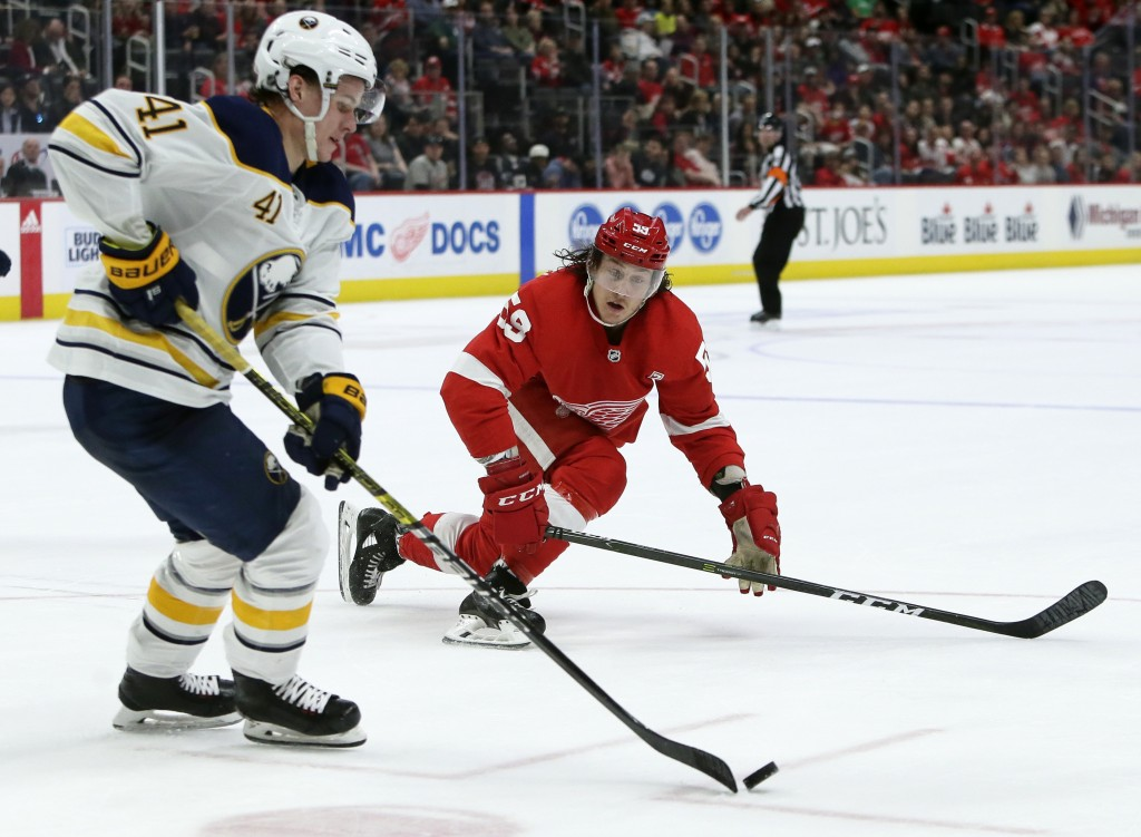 Detroit Red Wings left wing Tyler Bertuzzi (59) moves to block a pass by Buffalo Sabres left wing Victor Olofsson (41), of Sweden, during the second p...