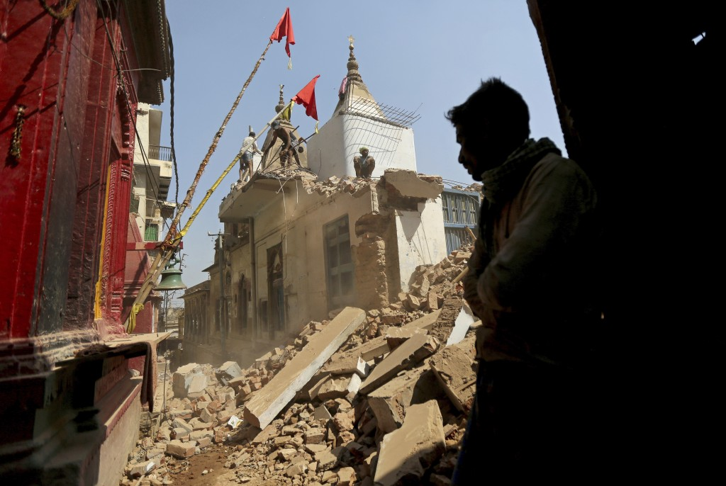 In this March 19, 2019, photo, workers demolish a house at the site of a proposed grand promenade connecting the sacred Ganges river with a centuries-...