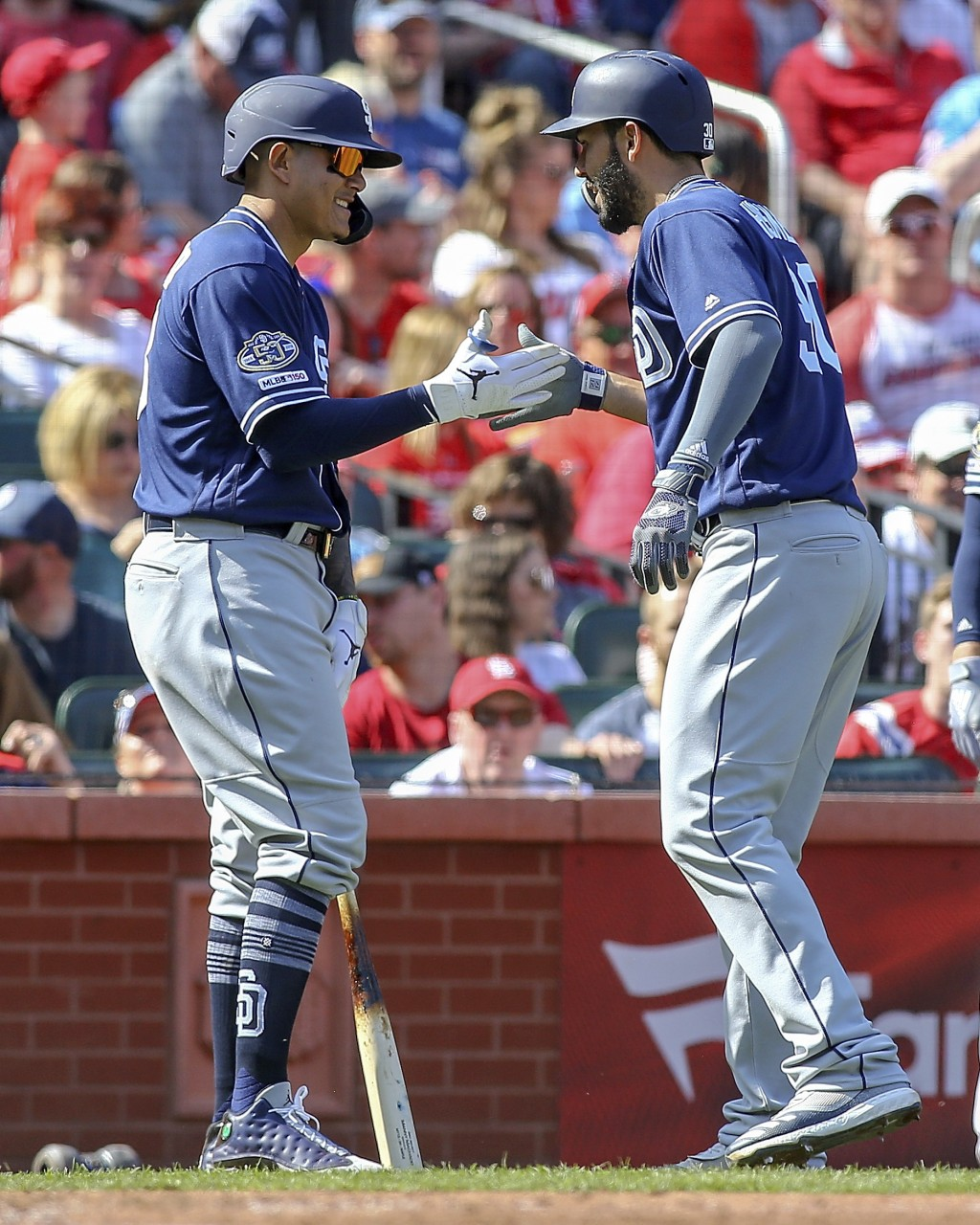 San Diego Padres' Manny Machado, left, celebrates with Eric Hosmer after Hosmer hit a solo home run during the seventh inning of a baseball game again