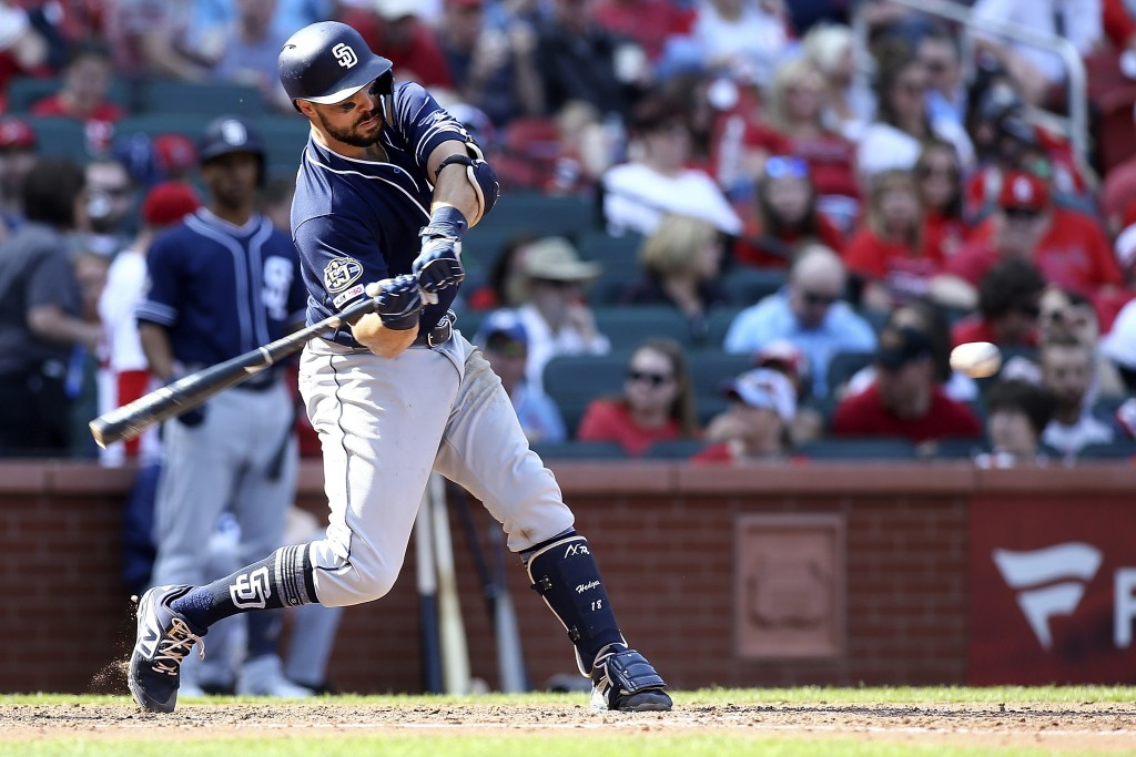 San Diego Padres' Austin Hedges swings for a two-run home run during the eighth inning of a baseball game against the St. Louis Cardinals, Saturday, A
