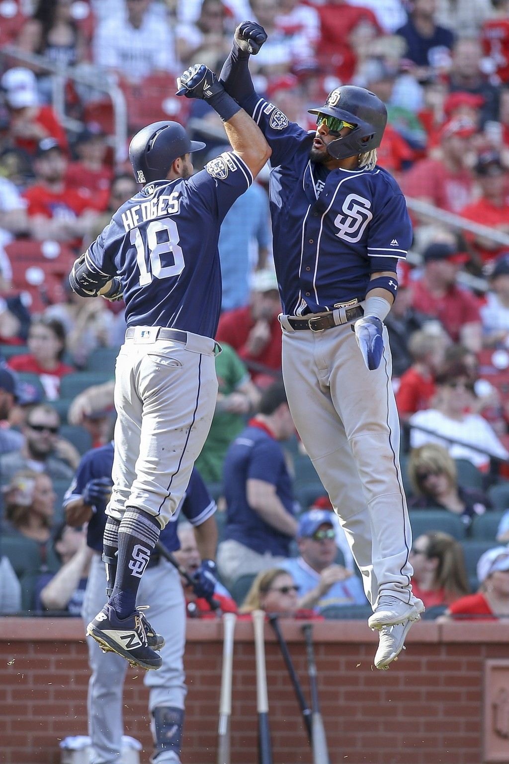 San Diego Padres' Austin Hedges, left, and Fernando Tatis Jr. celebrate after Hedges hit a two-run home run during the eighth inning of a baseball gam