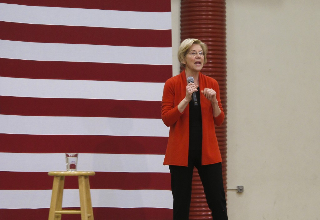 Sen. Elizabeth Warren, D-Mass., speaks to supporters at a rally for her Democratic presidential campaign at Wooster High School in Reno, Nev., Saturda