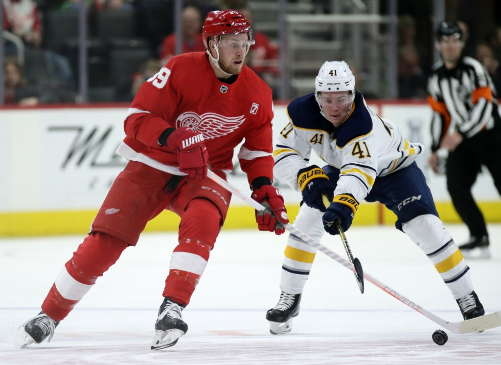 Detroit Red Wings right wing Anthony Mantha (39) has his stick knocked off the puck by Buffalo Sabres left wing Victor Olofsson (41), of Sweden, durin...