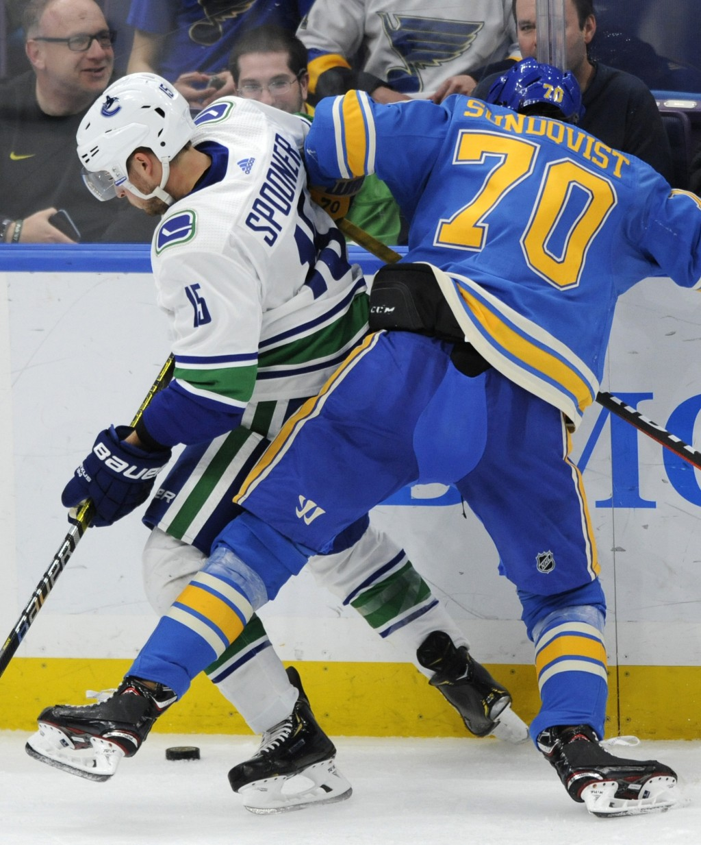 St. Louis Blues' Oskar Sundqvist (70), of Sweden, looks for the puck with Vancouver Canucks' Ryan Spooner (15) during the second period of an NHL hock