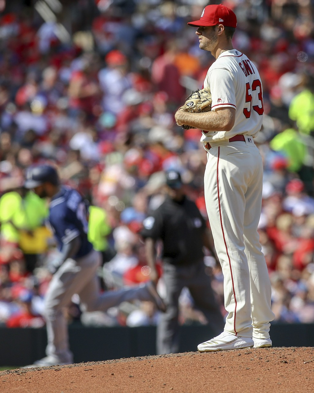 St. Louis Cardinals relief pitcher John Gant (53) pauses on the mound as San Diego Padres' Eric Hosmer runs the bases after hitting a solo home run du