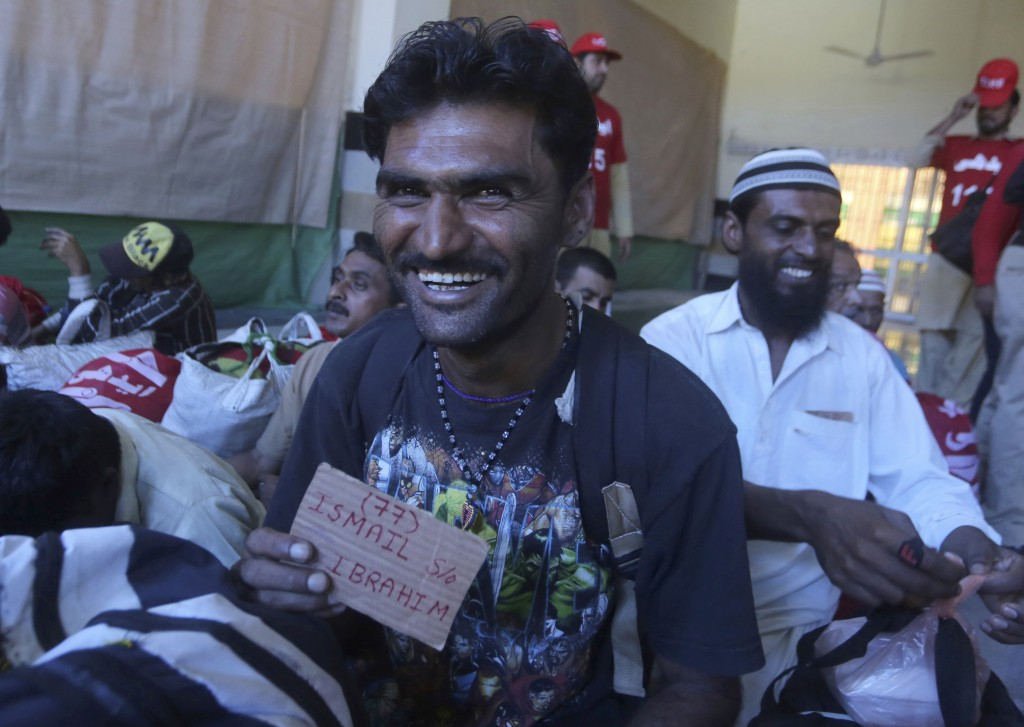Released Indian fisherman Ismail shows his name tag at Lahore railway station to leave for their homeland, in Pakistan, Monday, April 8, 2019. Pakista